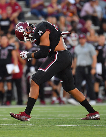 LAS CRUCES, NEW MEXICO - OCTOBER 05, 2019:  Defensive lineman Xander Yarberough #88 of the New Mexico State Aggies celebrates on the field after recording a sack against the Liberty Flames during their game at Aggie Memorial Stadium on October 05, 2019 in Las Cruces, New Mexico.  The Flames defeated the Aggies 20-13.  (Photo by Sam Wasson)