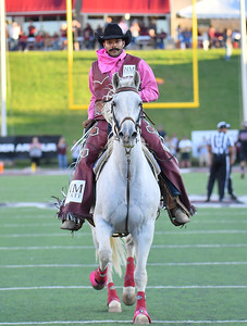 LAS CRUCES, NEW MEXICO - OCTOBER 05, 2019:  New Mexico State Aggies mascot Pistol Pete rides his horse on the field before the team's game against the Liberty Flames at Aggie Memorial Stadium on October 05, 2019 in Las Cruces, New Mexico.  The Flames defeated the Aggies 20-13.  (Photo by Sam Wasson)