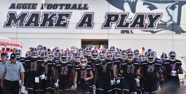 LAS CRUCES, NEW MEXICO - OCTOBER 05, 2019:  The New Mexico State Aggies line up to head onto the field before their game against the Liberty Flames at Aggie Memorial Stadium on October 05, 2019 in Las Cruces, New Mexico.  The Flames defeated the Aggies 20-13.  (Photo by Sam Wasson)