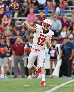 LAS CRUCES, NEW MEXICO - OCTOBER 05, 2019:  Quarterback Stephen Calvert #12 of the Liberty Flames throws a pass against the New Mexico State Aggies during their game at Aggie Memorial Stadium on October 05, 2019 in Las Cruces, New Mexico. The Flames defeated the Aggies 20-13.  (Photo by Sam Wasson)