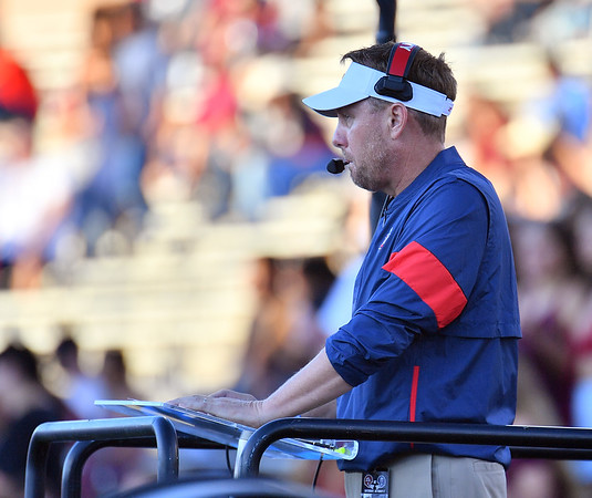 LAS CRUCES, NEW MEXICO - OCTOBER 05, 2019:  Head coach Hugh Freeze of the Liberty Flames coaches from an elevated platform during his team's game against the New Mexico State Aggies at Aggie Memorial Stadium on October 05, 2019 in Las Cruces, New Mexico. The Flames defeated the Aggies 20-13.  (Photo by Sam Wasson)