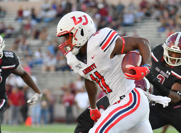 LAS CRUCES, NEW MEXICO - OCTOBER 05, 2019:  Wide receiver Antonio Gandy-Golden #11 of the Liberty Flames runs after catching a pass against the New Mexico State Aggies during their game at Aggie Memorial Stadium on October 05, 2019 in Las Cruces, New Mexico. The Flames defeated the Aggies 20-13.  (Photo by Sam Wasson)