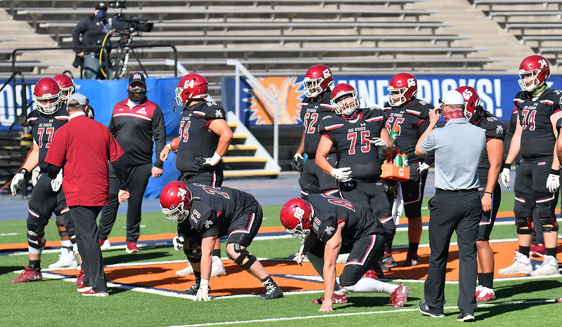 EL PASO, TEXAS - FEBRUARY 21, 2021:  The New Mexico State Aggies offensive line group warms up before their game against the Tarleton State Texans at Sun Bowl Stadium on February 21, 2021 in El Paso, Texas. The Texans defeated the Aggies 43-17.  (Photo by Sam Wasson/bleedCrimson.net)