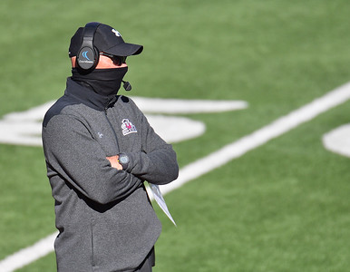 EL PASO, TEXAS - FEBRUARY 21, 2021:  Head coach Doug Martin of the New Mexico State Aggies looks on during the first half of their game against the Tarleton State Texans at Sun Bowl Stadium on February 21, 2021 in El Paso, Texas. The Texans defeated the Aggies 43-17.  (Photo by Sam Wasson/bleedCrimson.net)