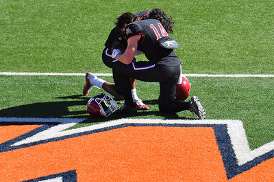 EL PASO, TEXAS - FEBRUARY 21, 2021:  Wide receiver Cole Harrity #14 and wide receiver Isaiah Garcia-Castaneda #2 of the New Mexico State Aggies kneel before the start of their team's game against the Tarleton State Texans at Sun Bowl Stadium on February 21, 2021 in El Paso, Texas. The Texans defeated the Aggies 43-17.  (Photo by Sam Wasson/bleedCrimson.net)