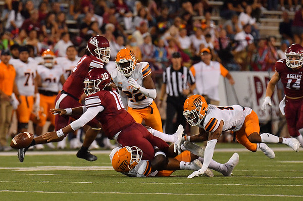 LAS CRUCES, NEW MEXICO - AUGUST 28:  Quarterback Jonah Johnson #10 of the New Mexico State Aggies fumbles the ball as he's tackled by defensive back Justin Prince #21 of the UTEP Miners in the first half of their game at Aggie Memorial Stadium on August 28, 2016 in Las Cruces, New Mexico.  (Photo by Sam Wasson/bleedCrimson.net)