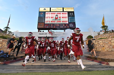 LAS CRUCES, NEW MEXICO - AUGUST 28:  The New Mexico State Aggies run onto the field before their game against the UTEP Miners at Aggie Memorial Stadium on August 28, 2021 in Las Cruces, New Mexico.  (Photo by Sam Wasson/bleedCrimson.net)