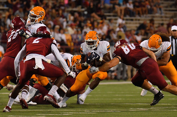 LAS CRUCES, NEW MEXICO - AUGUST 28:  Running back Deion Hankins #33 of the UTEP Miners runs the ball against defensive back Chris Bell #2 and linebacker Trevor Brohard #80 of the New Mexico State Aggies in the first half of their game at Aggie Memorial Stadium on August 28, 2016 in Las Cruces, New Mexico.  (Photo by Sam Wasson/bleedCrimson.net)