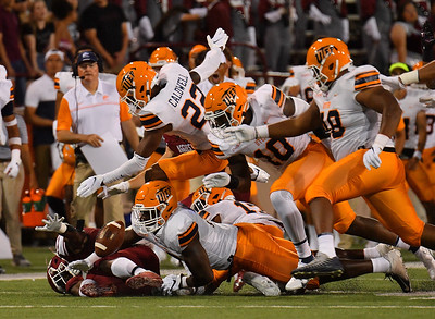 LAS CRUCES, NEW MEXICO - AUGUST 28:  Running back O'Maury Samuels #5 of the New Mexico State Aggies battles against a group of UTEP Miners defenders for a fumble in the first half of their game at Aggie Memorial Stadium on August 28, 2016 in Las Cruces, New Mexico.  (Photo by Sam Wasson/bleedCrimson.net)