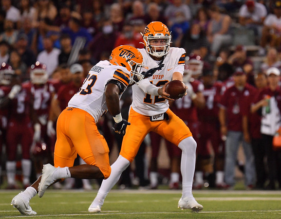 LAS CRUCES, NEW MEXICO - AUGUST 28:  Quarterback Gavin Hardison #12 hands the ball off to running back Deion Hankins #33 of the UTEP Miners in the first half of their game against the New Mexico State Aggies at Aggie Memorial Stadium on August 28, 2016 in Las Cruces, New Mexico.  (Photo by Sam Wasson/bleedCrimson.net)