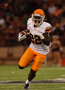 LAS CRUCES, NEW MEXICO - AUGUST 28:  Running back Ronald Awatt #22 of the UTEP Miners runs against linebacker Chris Ojoh #3 of the New Mexico State Aggies in the first half of their game at Aggie Memorial Stadium on August 28, 2016 in Las Cruces, New Mexico.  (Photo by Sam Wasson/bleedCrimson.net)