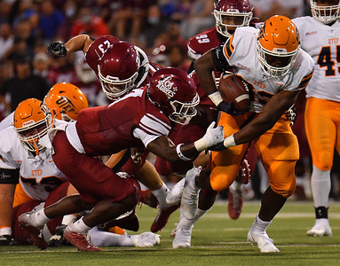 LAS CRUCES, NEW MEXICO - AUGUST 28:  Running back Deion Hankins #33 of the UTEP Miners escape a tackle attempt from defensive back D.J. McCullough #7 of the New Mexico State Aggies in the first half of their game at Aggie Memorial Stadium on August 28, 2016 in Las Cruces, New Mexico.  (Photo by Sam Wasson/bleedCrimson.net)