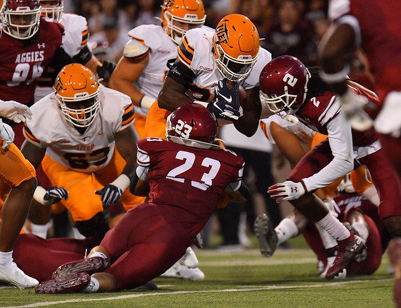 LAS CRUCES, NEW MEXICO - AUGUST 28:  Running back Deion Hankins #33 of the UTEP Miners runs against linebacker Dalton Bowles #23 and defensive back Chris Bell #2 of the New Mexico State Aggies in the first half of their game at Aggie Memorial Stadium on August 28, 2016 in Las Cruces, New Mexico.  (Photo by Sam Wasson/bleedCrimson.net)