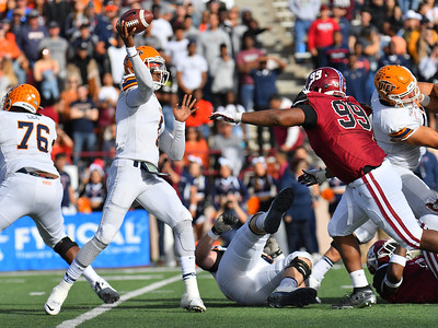 LAS CRUCES, NEW MEXICO - NOVEMBER 23, 2019:  Quarterback Kai Locksley #1 of the UTEP Miners throws a pass against defensive lineman Myles Vigne #99 of the New Mexico State Aggies during their game at Aggie Memorial Stadium on November 23, 2019 in Las Cruces, New Mexico.  (Photo by Sam Wasson/bleedCrimson.net)