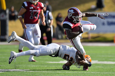 LAS CRUCES, NEW MEXICO - NOVEMBER 23, 2019:  running back Jason Huntley #1 of the New Mexico State Aggies runs for a gain against defensive back defensive back Josh Caldwell #22 of the UTEP Miners during their game at Aggie Memorial Stadium on November 23, 2019 in Las Cruces, New Mexico.  (Photo by Sam Wasson/bleedCrimson.net)