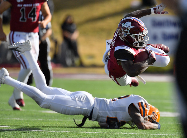LAS CRUCES, NEW MEXICO - NOVEMBER 23, 2019:  running back Jason Huntley #1 of the New Mexico State Aggies is tackled by defensive back Josh Caldwell #22 of the UTEP Miners during their game at Aggie Memorial Stadium on November 23, 2019 in Las Cruces, New Mexico.  (Photo by Sam Wasson/bleedCrimson.net)