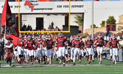 LAS CRUCES, NEW MEXICO - NOVEMBER 23, 2019:  The New Mexico State Aggies run onto the field before  their game against the UTEP Miners at Aggie Memorial Stadium on November 23, 2019 in Las Cruces, New Mexico.  (Photo by Sam Wasson/bleedCrimson.net)