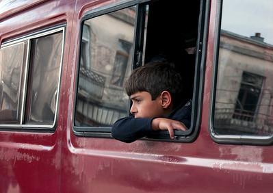 A Boy Looks Out a Bus Window, Kutaisi, Georgia