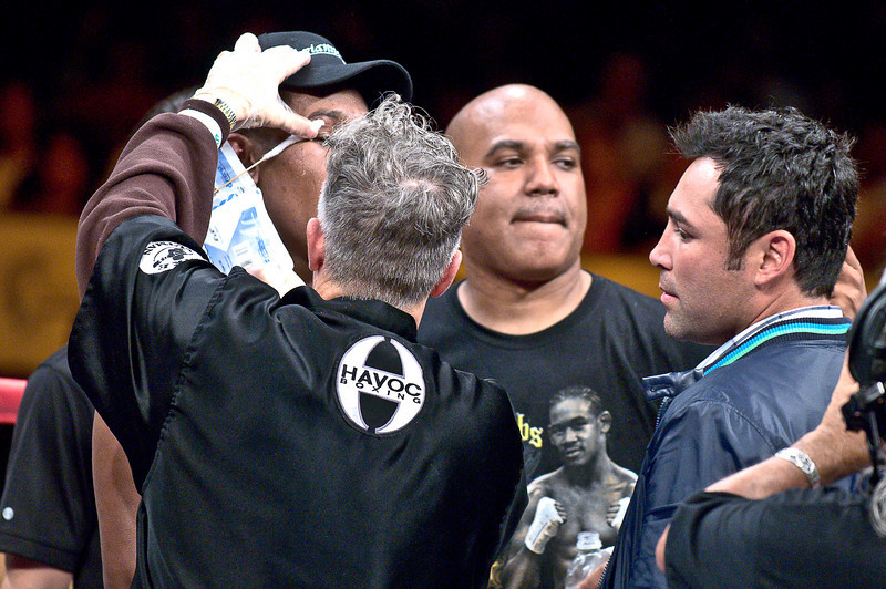 (6.26.2009 -- Tucson) Oscar de la Hoya in the ring congratulating Daniel Jacobs after his 8th round TKO over George Walton.<br /> <br /> Images from the Golden Boy Promotions fight card at the Desert Diamond Casino.