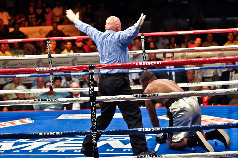 (6.26.2009 -- Tucson)  Referee Wes Melton counts Kelsey Arnold on the canvass after being knocked out in the 1st round by Deontay Wilder in their Heavyweight bout.<br /> <br /> Images from the Golden Boy Promotions fight card at the Desert Diamond Casino.