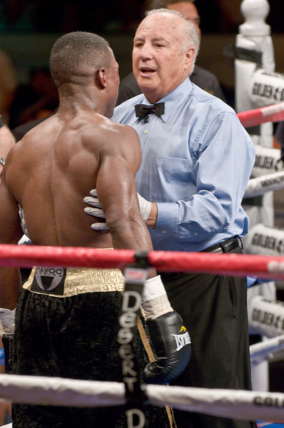 (6.26.2009 -- Tucson)  Referee Bobby Ferrara telling George Walton that he will not be able to continue his fight with Daniel Jacobs.  This gave Jacobs an 8th round TKO victory.<br /> <br /> Images from the Golden Boy Promotions fight card at the Desert Diamond Casino.