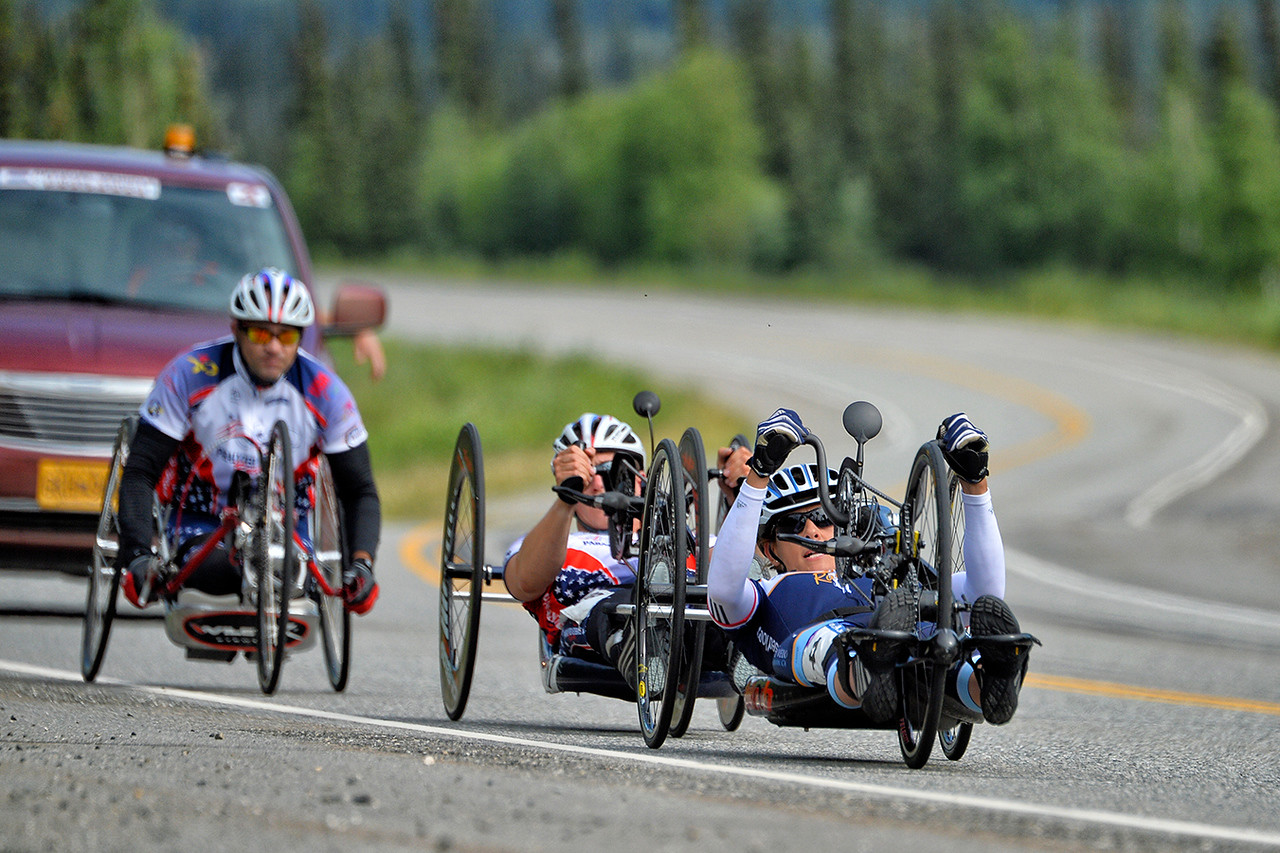 July 18, 2013: Sadler's Alaska Challenge Stage Three - Milepost 264 to Milepost 318. Thea Rosa (Cool, Calif.), Jacob Freeland (Asheville, N.C.) and Robert Puckett III (St. Petersburg, Fla.) race on the Parks Highway during stage three. The stage began at milepost 264 north of Nenana, AK and finished at milepost 318 north of Healy, AK.