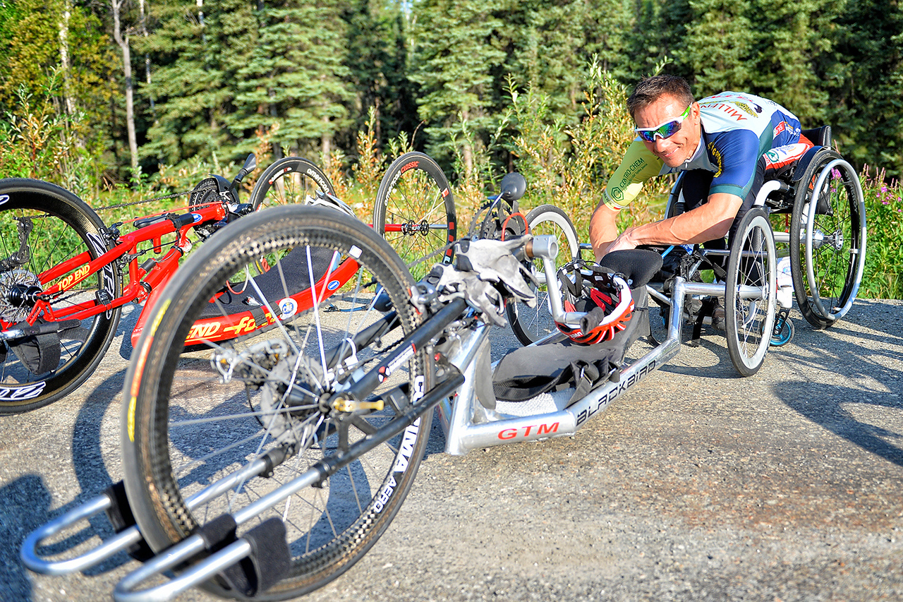 July 18, 2013: Sadler's Alaska Challenge Stage Three - Milepost 264 to Milepost 318. Rafal Wilk (Rzezow, Poland) works on his handcycle before the start of stage three. The stage began at milepost 264 north of Nenana, AK and finished at milepost 318 north of Healy, AK. Wilk finished the 50-mile stage in 2:11:19.