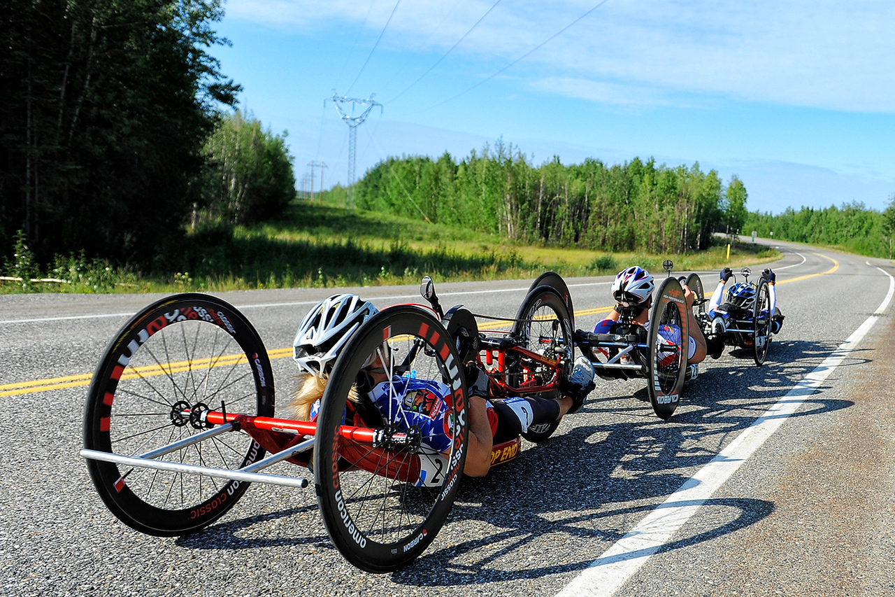 July 18, 2013: Sadler's Alaska Challenge Stage Three - Milepost 264 to Milepost 318. A group of three handcyclists race on the Parks Highway during stage three. The stage began at milepost 264 north of Nenana, AK and finished at milepost 318 north of Healy, AK.