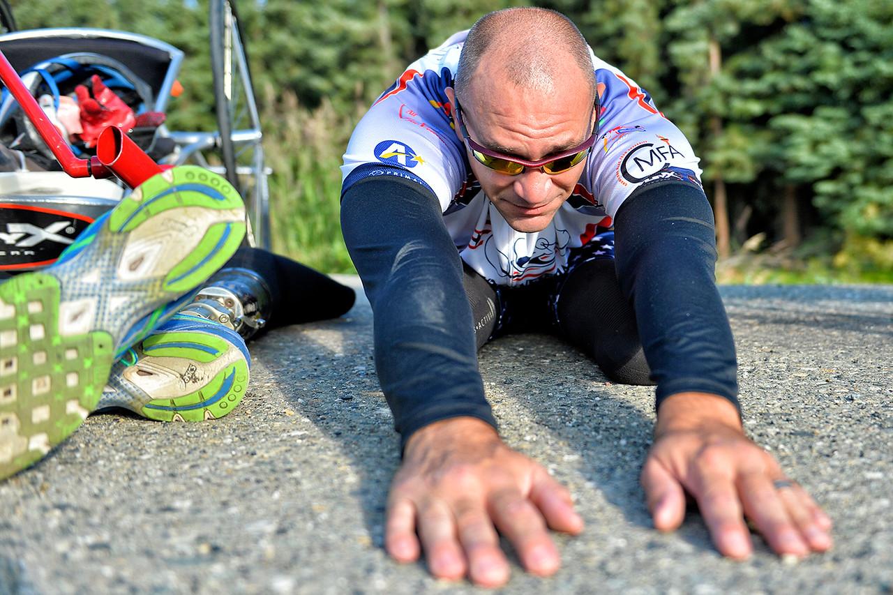 July 18, 2013: Sadler's Alaska Challenge Stage Three - Milepost 264 to Milepost 318. Robert Puckett III (St. Petersburg, Fla.) stretches before the start of stage three. The stage began at milepost 264 north of Nenana, AK and finished at milepost 318 north of Healy, AK. Puckett  finished the 50-mile stage in 2:53:56.