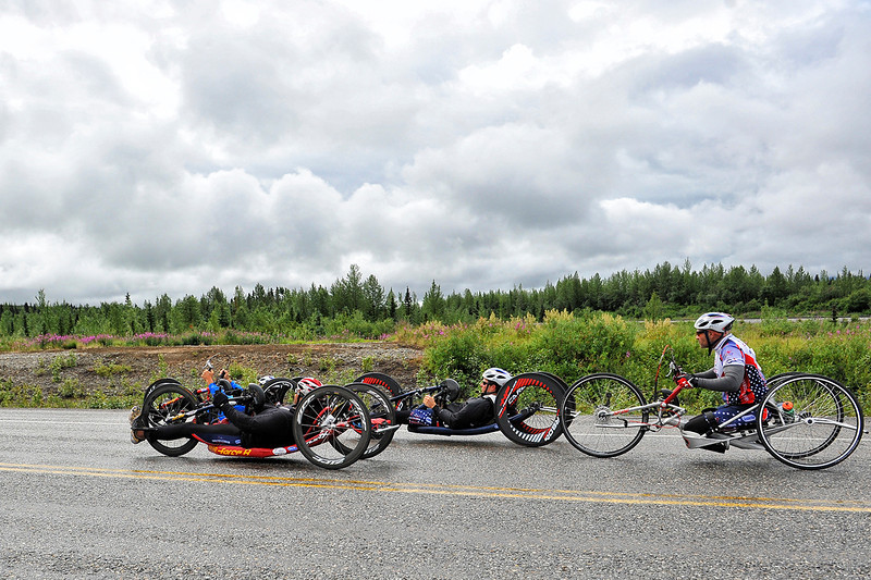 July 19, 2013: Sadler's Alaska Challenge Stage Five from Milepost 211 to Milepost 183. A group of four handcyclists race along the Parks highway during stage five.