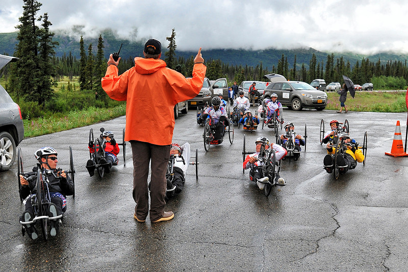 July 19, 2013: Sadler's Alaska Challenge Stage Five from Milepost 211 to Milepost 183. Race technical director Ian Lawless delivers final instructions to the handcyclists before the start of stage five.