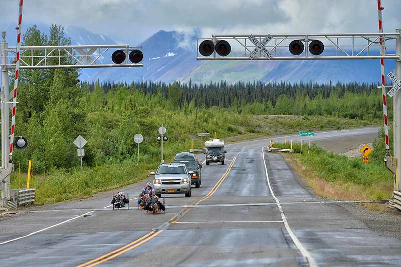 July 19, 2013: Sadler's Alaska Challenge Stage Five from Milepost 211 to Milepost 183. A group of handcyclists race along the Parks highway during stage five.