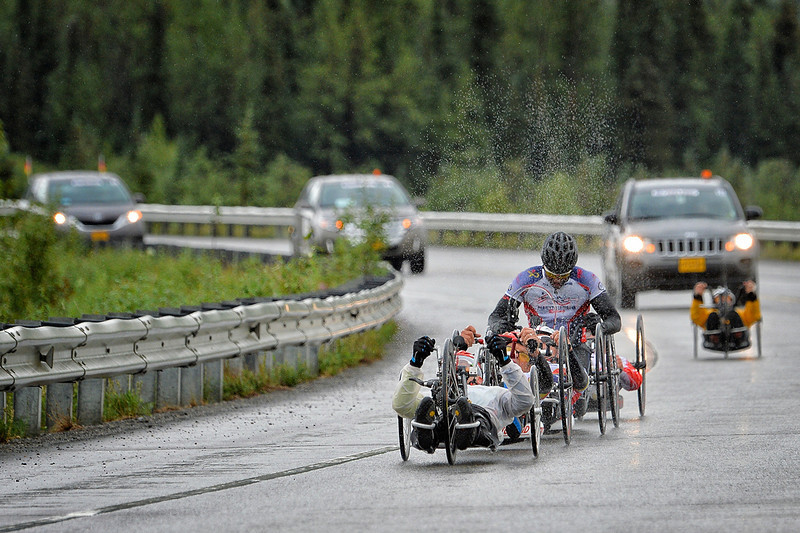 July 19, 2013: Sadler's Alaska Challenge Stage Five from Milepost 211 to Milepost 183. A pack of six handcyclists race along the Parks highway during stage five.