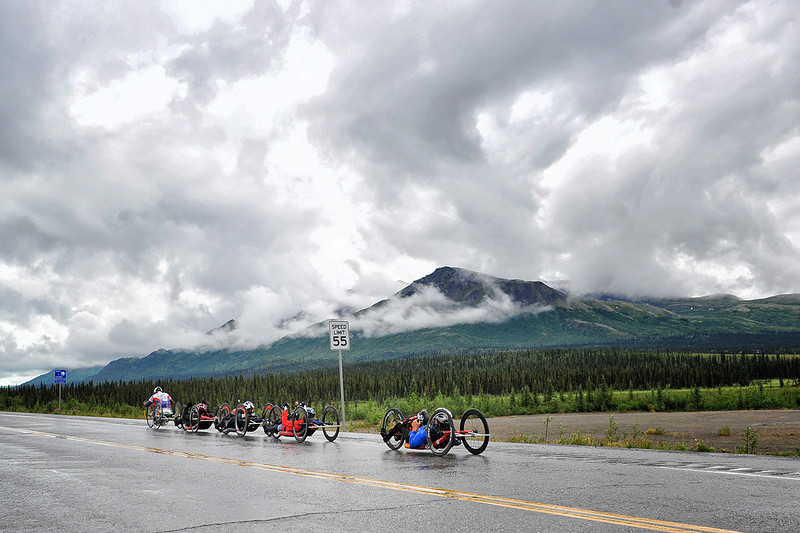 July 19, 2013: Sadler's Alaska Challenge Stage Five from Milepost 211 to Milepost 183. A group of five handcyclists race along the Parks highway during stage five.