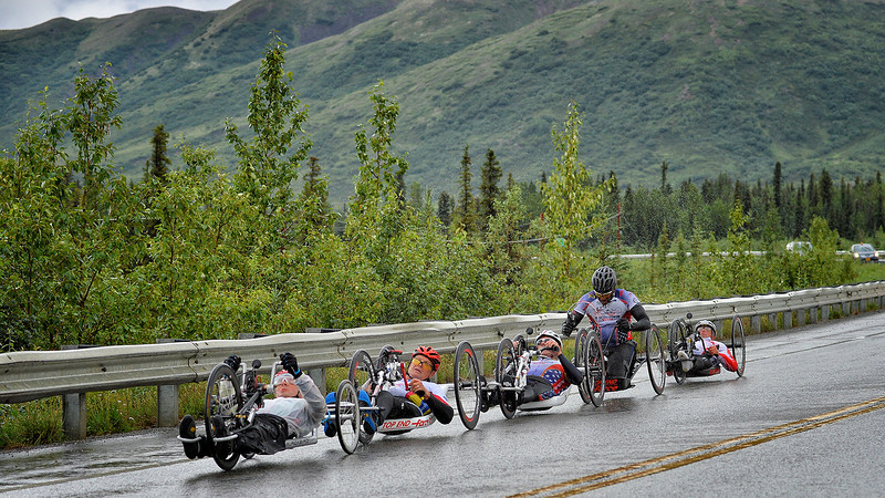July 19, 2013: Sadler's Alaska Challenge Stage Five from Milepost 211 to Milepost 183. A pack of five handcyclists race along the Parks highway during stage five.