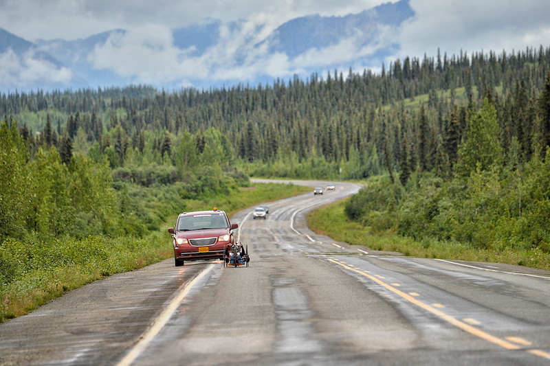 July 19, 2013: Sadler's Alaska Challenge Stage Five from Milepost 211 to Milepost 183. A pair of handcyclists race along the Parks highway during stage five.