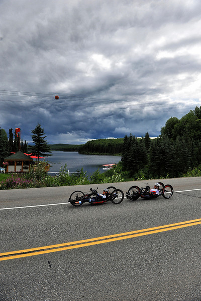 July 20, 2013: Sadler's Alaska Challenge Stage Six from Denali View South to Talkeetna Alaskan Lodge. Thea Rosa (Cool, Calif.) and Jacob Freeland (Asheville, N.C.) race along Talkeenta Spur Road during stage six.