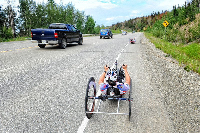 July 17, 2013: Sadler's Alaska Challenge Stage Two - Ester, Alaska to Nenana, Alaska. Traffic passes Gerard Ah Fook (Tucson, Ariz.) and Jacob Freeland (Asheville, N.C.) as they race on the Parks Highway during stage two from Ester, AK to Nenana, AK.