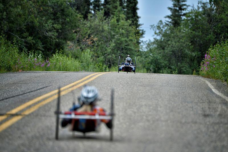 July 17, 2013: Sadler's Alaska Challenge Stage Two - Ester, Alaska to Nenana, Alaska. Carrie Finale (Navarre, Fla.) leads Thea Rosa (Cool, Calif.) up a hill on the Old Nenana Highway during stage two from Ester, AK to Nenana, AK.