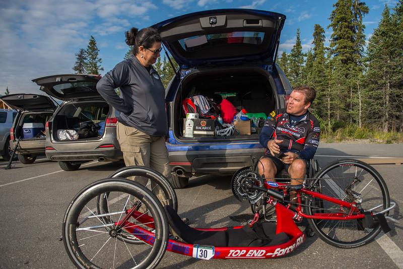 July 25, 2015: Wesley Bergin and race volunteer Joana Moleda stage five of the 2015 Alaska Challenge handcycle race.