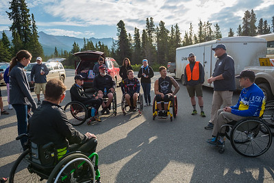 July 25, 2015: Technical director Jeff Dick briefs the racers before the start of stage five of the 2015 Alaska Challenge handcycle race.