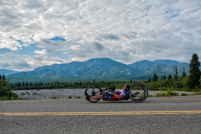 July 25, 2015: David Neumer races along Denali Park Road during stage five of the 2015 Alaska Challenge handcycle race.