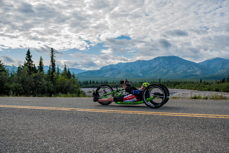 July 25, 2015: Keith Winchell races along Denali Park Road during stage five of the 2015 Alaska Challenge handcycle race.