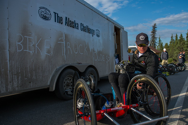 July 25, 2015: Muffy Davis works on her bike before the start of stage five of the 2015 Alaska Challenge handcycle race.