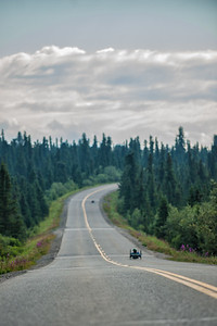 July 25, 2015: A pair of racers race along Denali Park Road during stage five of the 2015 Alaska Challenge handcycle race.