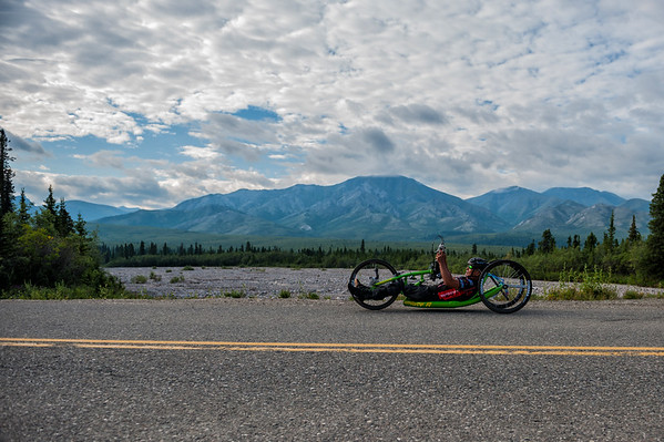 July 25, 2015: Mike O'Neill races along Denali Park Road during stage five of the 2015 Alaska Challenge handcycle race.