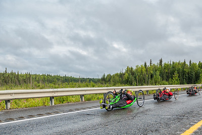 July 26, 2015: Keith Winchell, Kenny Herriot and David Neumer race along the Parks Highway during stage seven of the 2015 Alaska Challenge handcycle race.