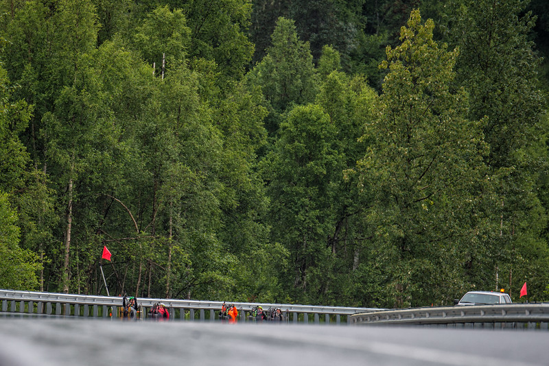 July 26, 2015: Racers come around a corner during stage seven of the 2015 Alaska Challenge handcycle race.