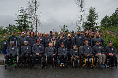 July 26, 2015: Racers and volunteers post for a group photo before the start of stage seven of the 2015 Alaska Challenge handcycle race.