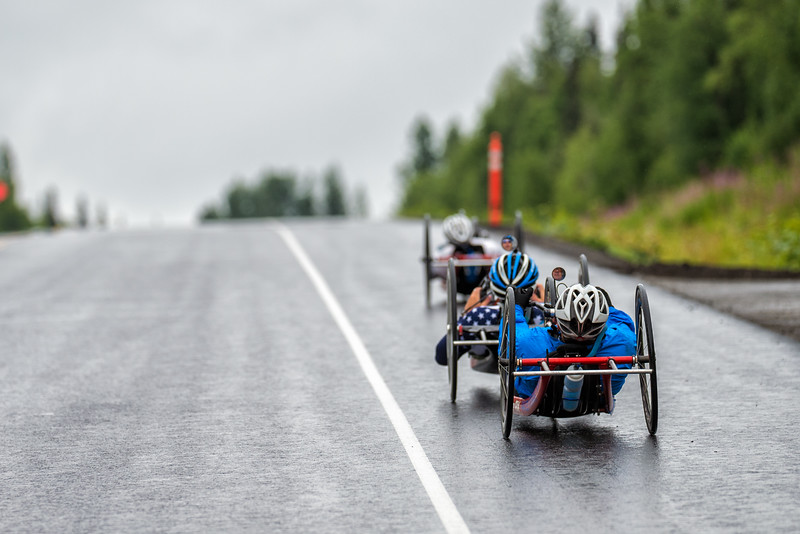 July 26, 2015: A group of racers race along the Parks Highway during stage seven of the 2015 Alaska Challenge handcycle race.